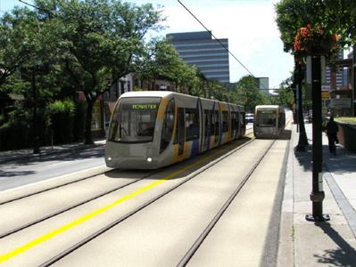 This illustration shows an artists conception of LRT trains moving west along King Street, near Hess and Caroline Streets. - The City of Hamilton
